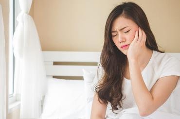 How To Sleep After Wisdom Teeth Removal - 4 Tips That Will Help You